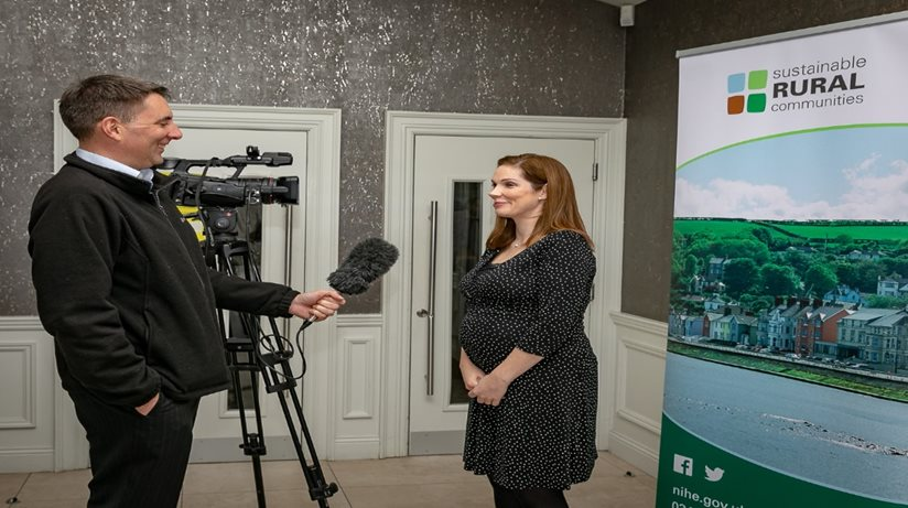 BBC interviewer with the Housing Executive's Sinead Collins