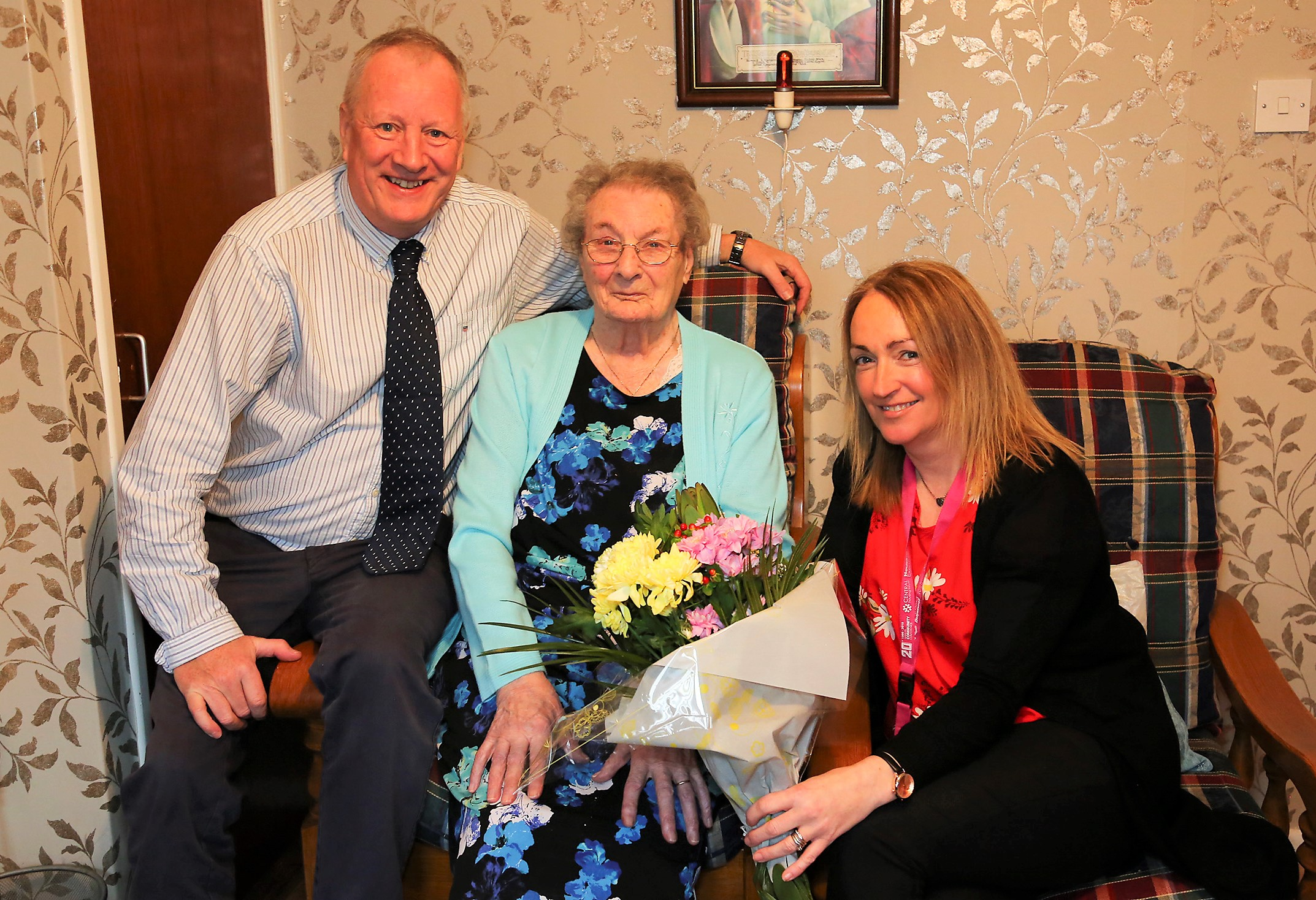 Housing tenant celebrates 100th birthday with Housing exacutive staff
