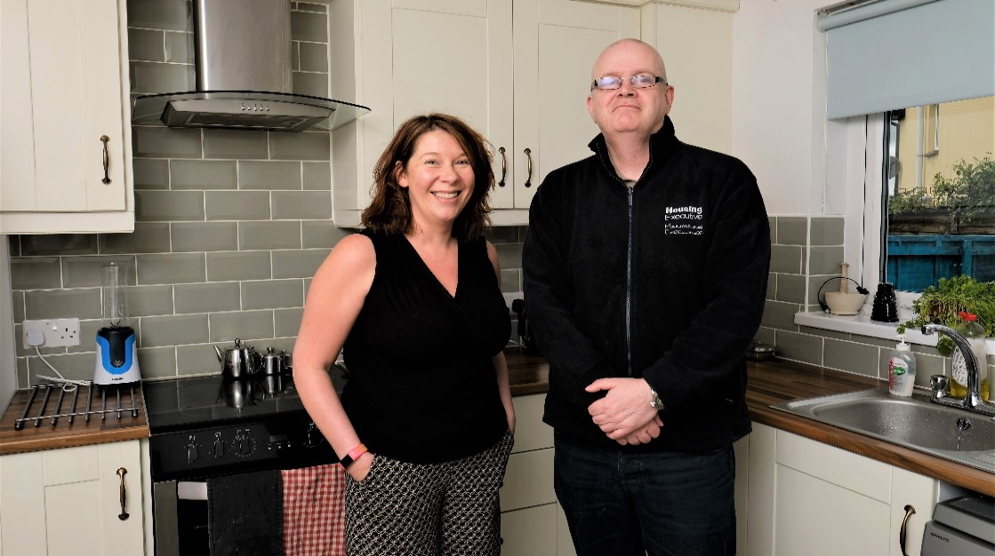 Tenants pictured in their new kitchen