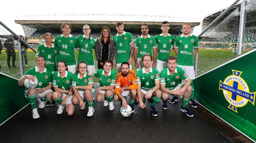 NI Street Soccer team pose for the camera at Windsor Park