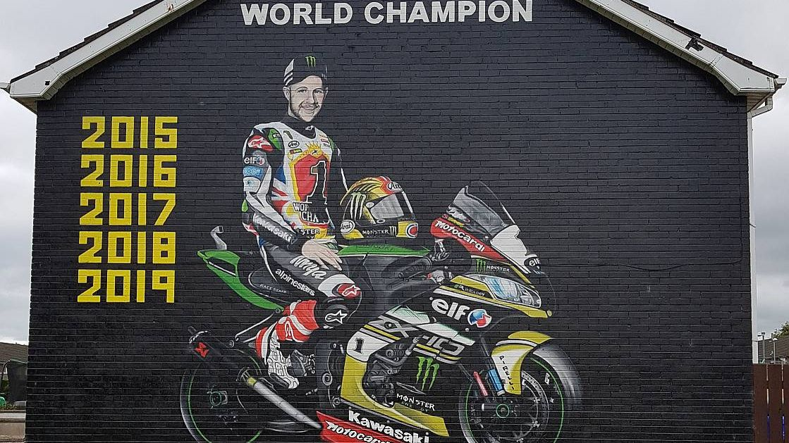Mural of Jonathan Rea on the side of house.
